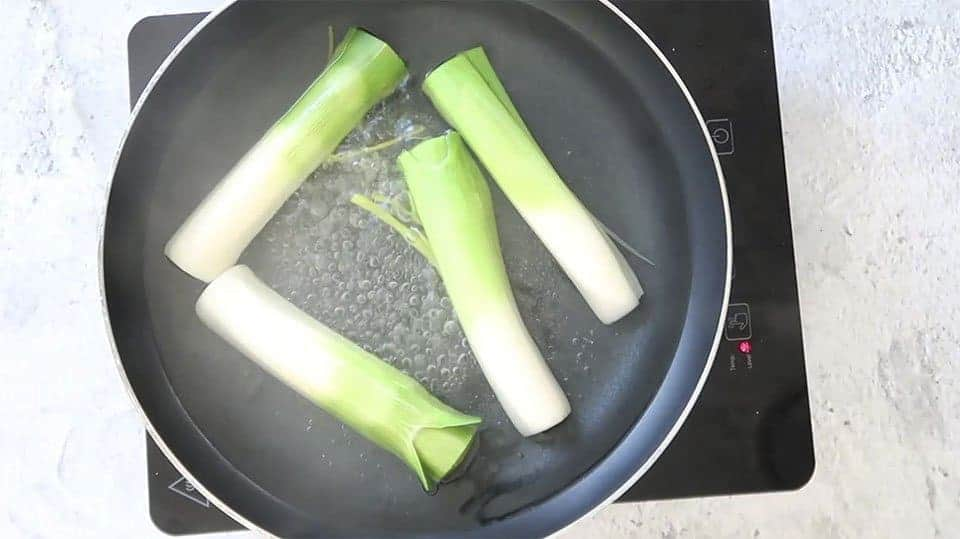 poaching leeks to place in the Festive Chicken Terrine