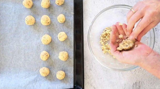 hand rolling the Walnut Snowball Cookie mixture ready for baking