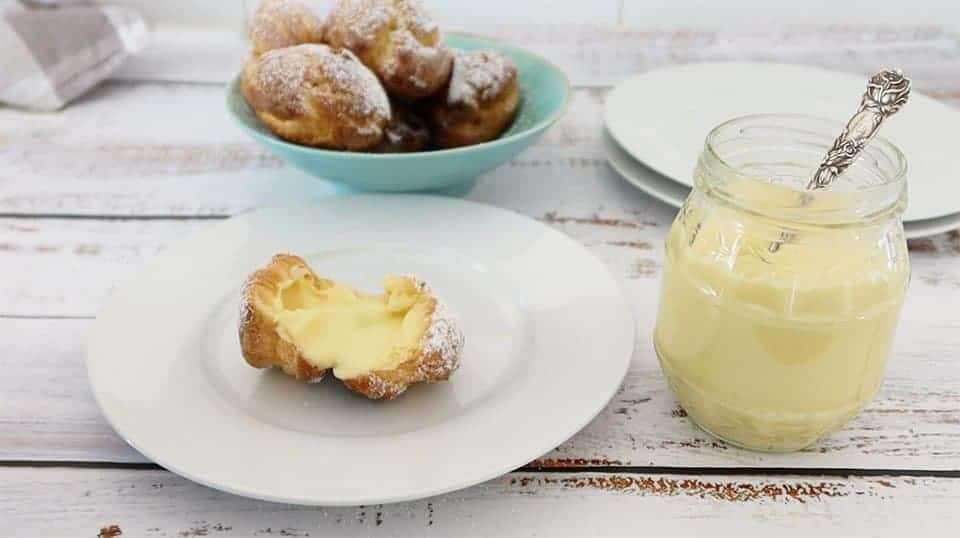 Creme Patissiere in a glass jar on a timber table