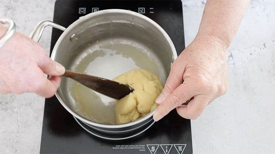 forming the dough into a ball to show the steps for The Definitive Guide to Making Choux Pastry