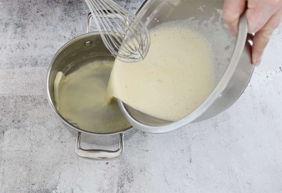 returning the egg and milk mixture back to the pot to make creme patissiere