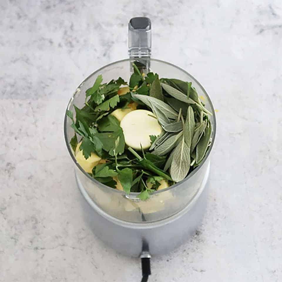 Ingredients in a blender to make Orange and Sage Turkey Roulade