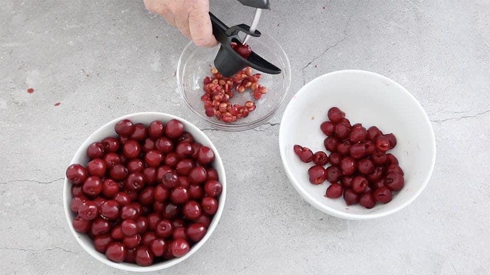 pipping cherries to make homemade cherry pie recipe